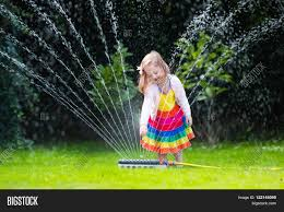 Child Playing Garden Sprinkler. Image & Photo | Bigstock Sprinklers Photos Portland Rain Bird 32eti Easy To Install Automatic Sprinkler System 25 Unique Kids Sprinkler Ideas On Pinterest Drive Through Car Tips Installing A Diy Fun Outdoor Acvities To Battle Sumrtime Heat Good Matters Blog When Putting In System How Do You Measure The Pipe For Erground Open Dirt Trenches During Simple Pvc The Crafty Stalker How Howtos Irrigation Repair Landscaping Systems And Backyard Fun Youtube 10 Ways You Can Save Water In