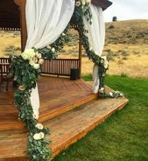 Green and White Floral Outdoor Wedding Ceremony Pinterest