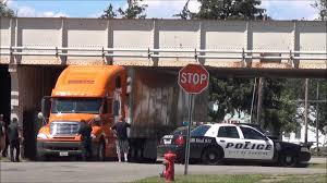 Truck Driver Underestimates The Clearance Of A Bridge & Gets Stuck!