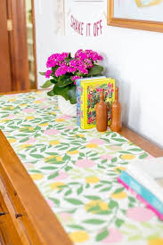12 Embellish The Top Of Your Dresser With Colorful Wallpaper And A Few Favorite Books