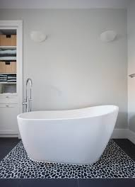 soaking tub and river rock tile portage bay playroom and more by