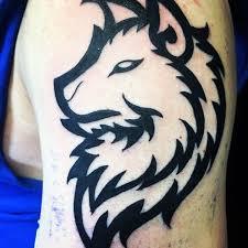Bold Black Ink Tribal Wolf Male Upper Arm Tattoo