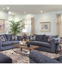 blue velvet sofa with light blue pillows transitional living