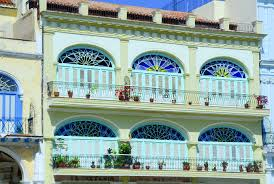Historic Architecture Of Cuba Is Preserved In Old Havana Colorful Building Seen On People
