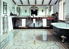 French Country Bathroom With Black Bathtub And Patterned Ceramic Floor Metallic Towel Holder