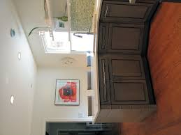 Allurng L Shape Kitchen Decoraton Ideas Using Grey Wood Counter Along With Cream Granite Tops And Stainless Steel Corner Sink