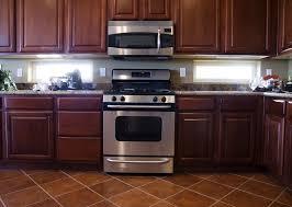 Kitchen Backsplash Ideas With Dark Wood Cabinets by Mahogany Kitchen Cabinets Modernize