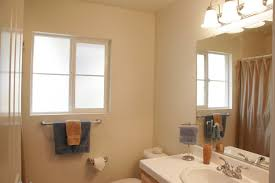 Small Bathroom Window Treatments by Which Shutters Are Right For A Bathroom