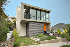 Fantastic Graded House With Grey Wall Cubic Facade And Large Glass ... Small Minimalist Home With Creative Design Architecture Beast Fantastic Graded House Grey Wall Cubic Facade And Large Glass A That Goes Modern Behind Its Traditional Milk Wooden Facade House Design By Saota Family Open Space In Montral Canada Beechmont 204 Stroud Homes Facades Singh Rippling Red Brick Shades In Surat Work Group 42 Stunning Exterior Designs Plans For Sale Online