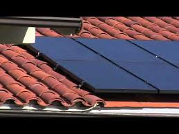 revco solar panels on a clay tile roof