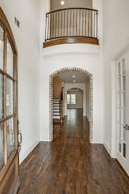 French-Style La Cantera Home. Exposed Brick Arch. Entry Archway ... 78 Best Stairs In Homes Images On Pinterest Architecture Interior Stair Banisters Railings For Residential Building Our First Home With Ryan Half Walls Vs Pine Modern Banister Styles Unique And Creative Staircase Designs 20 Hodorowski Foyers And The Stairs Are A Fail But The Banister Is Bad Ass Happy House Baby Proofing Child Safe Shield 77 Spindle Handrail Best 25 Split Entry Remodel Ideas Netting Safety Net Gallery
