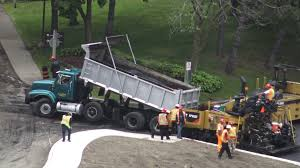 Truck Driver Raises The Body Of A Dump Truck To Load Hot Asphalt To ...