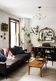Rustic Living Room With Painted White Brick Walls And Dark Furniture