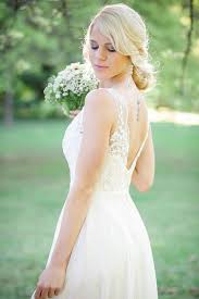 A Deep V Style Lace Back Wedding Dress Shows Off Tattoo Lovely Rustic Garden Picnic