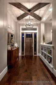 Transitional Entryway With Built In Bookshelf Flush Light Hardwood Floors