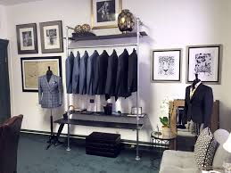 This Clothing Rack By Philippe Hass Bespoke Tailoring Is Mounted To The Wall And Ground Using Flange Fitting It Also Features Incorporated Shelving