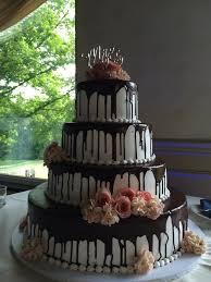 Tiers of Fresh Flowers on Chocolate Iced Wedding Cake