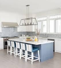 gray and blue kitchen with gray mini brick backsplash tiles