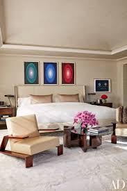 James Turrell Artworks Are Displayed Above Kourtneys Bed The Vintage Jean Michel Frank Lounge