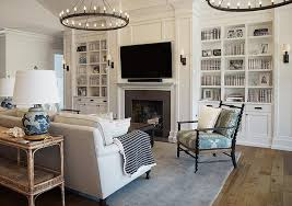 fireplace wall with floor to ceiling built in bookshelves