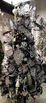 The Whole Tree Heavily Covered With Romantic Black And White Ornaments