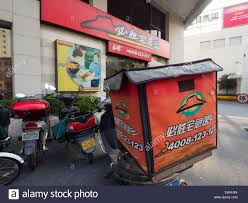 Delivery Motorcycle Outside A Pizza Hut Restaurant In Shanghai China