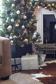 A Christmas Decor In Gold Silver And Copper