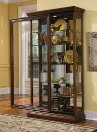Stunning Curio Cabinet For Modern Home Furniture Ideas With Sliding Door Design And Glass Material Also Shelves