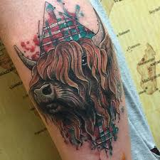 Wonderful Scottish Buffalo Tattoo On Forearm