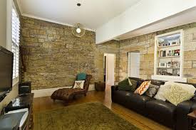 The Contemporary Wood Flooring Sconce Lighting And Comfortable Seating Are Only Modern Touches In Romantic Living Space