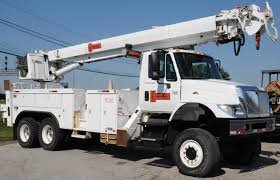 100 Derrick Truck INTERNATIONAL 2006 7400 ALTEC TANDEM AXLE AUGERDIGGER DERRICK