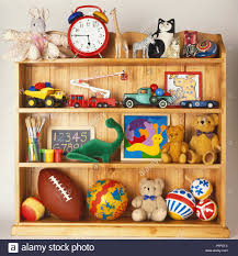 100 Balls On Trucks Wooden Bookcase Stacked With Toys Including Rubber Balls Cuddly
