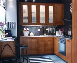 Frosted Glass Cabinet Kitchen Door With Black Pattern Tile Backsplash And Appliances Shelves In Small Apartment