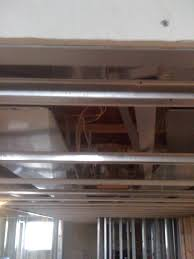 Installing Drywall On Ceiling In Basement by Should You Use Drywall Or Acoustic Drop Ceiling Tiles For Your