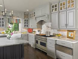 White Wellborn Cabinets With Silver Oven On Wooden Floor For Kitchen Decor Ideas