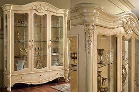 vitrinenschrank wohnzimmerschrank glastüren schubladen holz