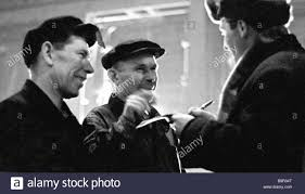 A Local Factory Newspaper Reporter Right Interviewing The Workers At Moscow Hammer And Sickle