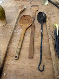 medieval kitchen utensils wooden ladel long handled spoons and