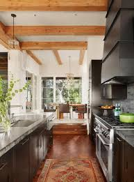 100 Exposed Joists Kitchen Featuring Soapstone Counters Dark Red Tiles And