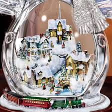 Thomas Kinkade Christmas Tree Village by The Thomas Kinkade Illuminated Crystal Snowman Hammacher Schlemmer