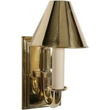 gold polished brass period candle style wall light with metal shade