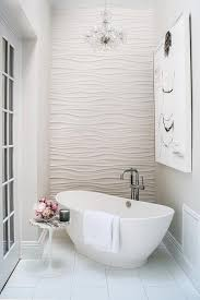 Modern Chandelier Over Bathtub by Romantic Bathroom Features An Accent Wall Clad In Wavy Tiles