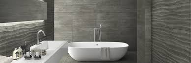and groove large format concrete look bathroom tiles