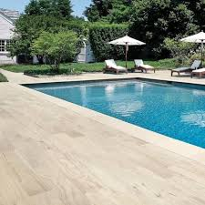 pool with wood plank tile surround traditional pool atlanta