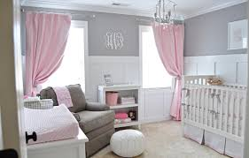 interior white wooden baby bedding with two pink curtains also