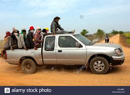 100 Small Pickup Truck Pickup Truck Carrying Farm Workers In The Crowded Cargo Bay On
