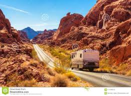 100 Valley Truck And Trailer Motorhome Traveling On The Road In Of Fire