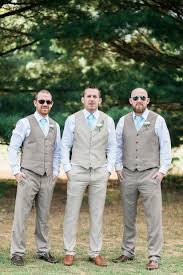 Groom And Groomsmen Khaki Slacks Vests Blue Button Downs Turquoise Ties Boutonniere