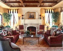 Colorful Farmhouse Living Room Mediterranean With Tuscan Carved Stone Fireplace Iron Sconces