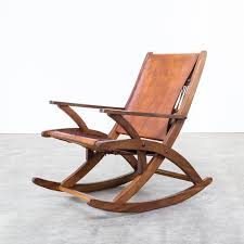 Mid Century Oak And Saddle Leather Rocking Chair - 1960s - Design Market Vintage Leather Rocking Chair Jack Rocker In Various Colors Burke Decor Uhuru Fniture Colctibles Folding 125 Chairs Armchairs Stools Archivos Moycor West Coast Fruitwood Folding Chair With Leather Seat Lutge Gallery By Ingmar Relling For Westnofa 1960s And Wood Boat Angel Pazmino Lounge Muebles De Estilo Spanish Ralph Co Midcentury Modern Costa Rican Campaign Antique Upholstered Flippsmart